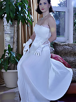 Sexy bride wears her wedding gown with gloves and white back seam pantyhose