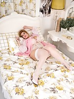 Cuddly blonde Ellie is ready for bed in her pretty lingerie, ivory stockings and pink heels!
