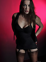 Nylon Jane looks fucking sexy and seductive as she poses with a dark backdrop and black lingerie.
