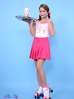 Irresistible waitress Kelli Smith in pink miniskirt and skates delivers a perfect striptease during sweet accident