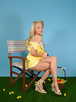 Gorgeous long legged blonde in pretty miniskirt dress, creates a very sexy Easter Chick themed striptease